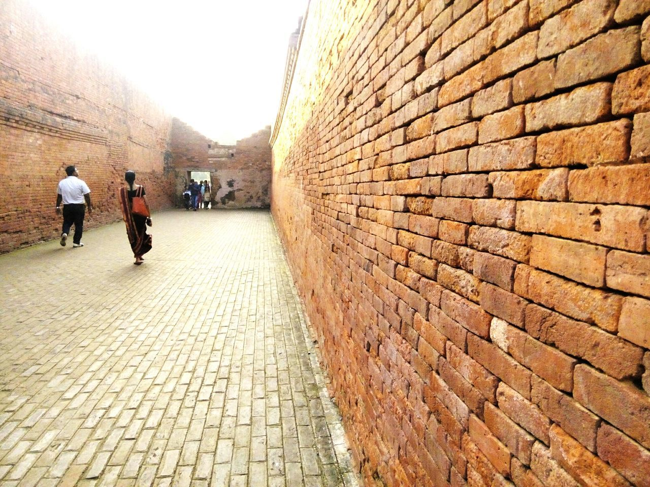 Beautifully Organized Bricks Brick Wall Built Structure Men Outdoors Real People Architecture Day Brickswork Brickstreet Brick Work Bricks Collection Historical Architecture Historic Building