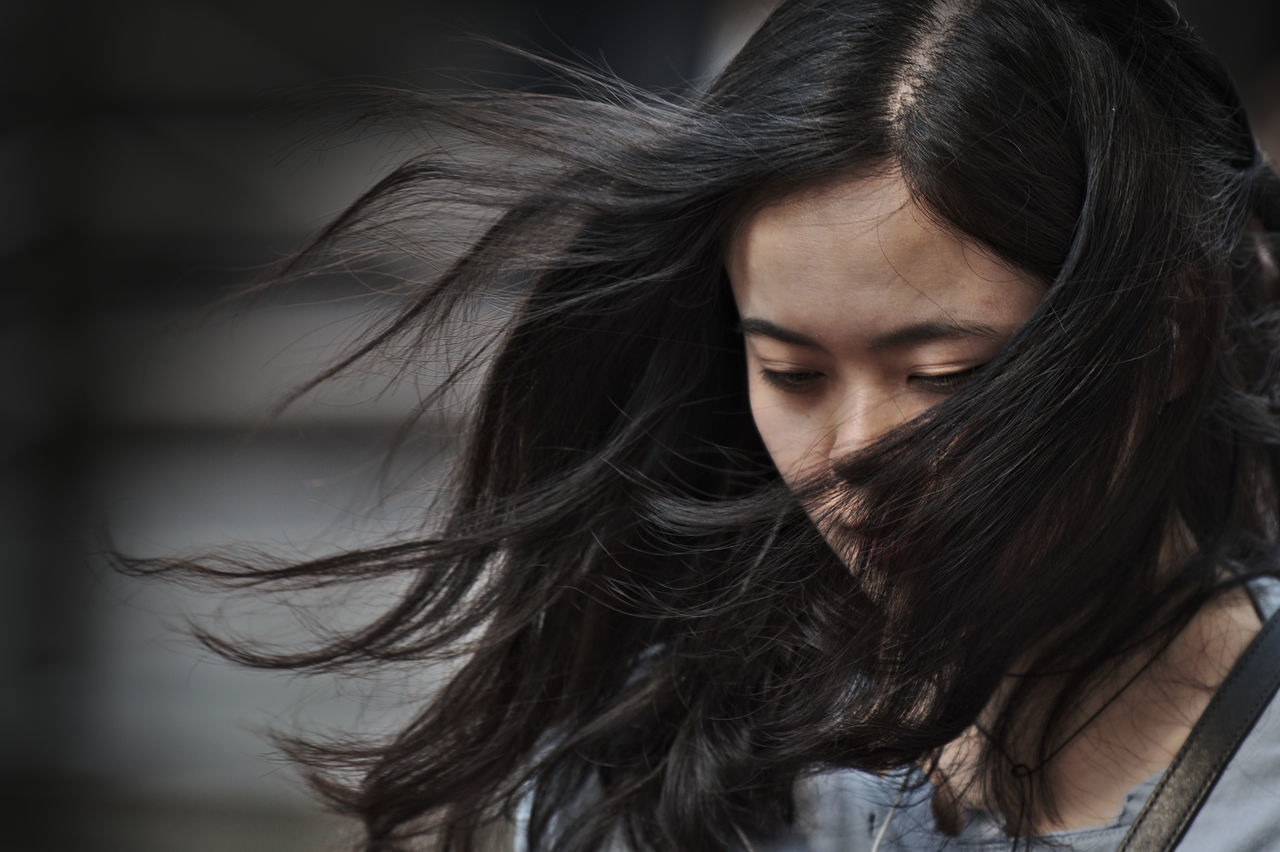 Beautiful Woman Beauty Black Hair Close-up Day Hair In Face Hair In The Wind Inward Look Lifestyles Long Hair One Person Outdoors People Real People Young Adult Young Women