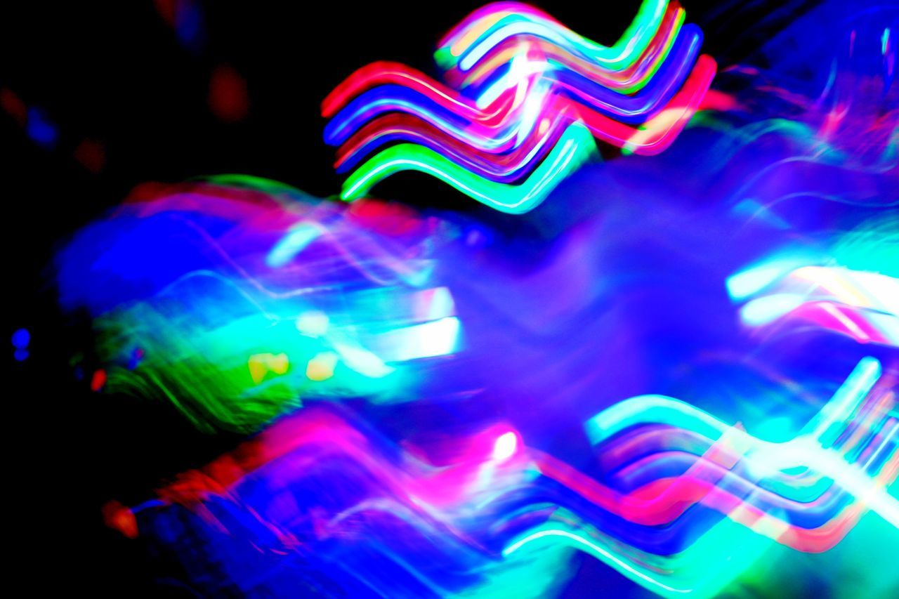 multi colored, illuminated, night, long exposure, arts culture and entertainment, neon, light trail, speed, nightlife, outdoors, no people, close-up, disco lights