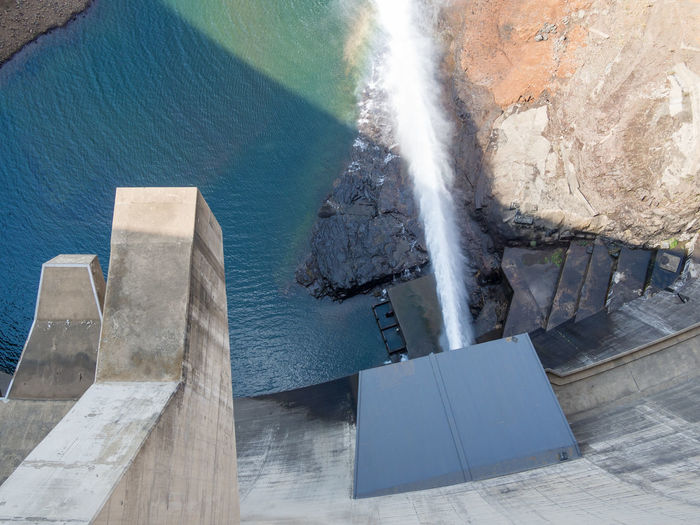 Top view of release of water at impressive Katse Dam hydroelectric power plant in Lesotho, Africa Construction Katsedam Lesotho Overflow Power Unique Perspectives Wall Aerial View Africa Beauty In Nature Concrete Dam Day Electricity  High Angle View Hydroelectric Power Landmark Manmade Nature No People Outdoors Reservoir River Sea Water