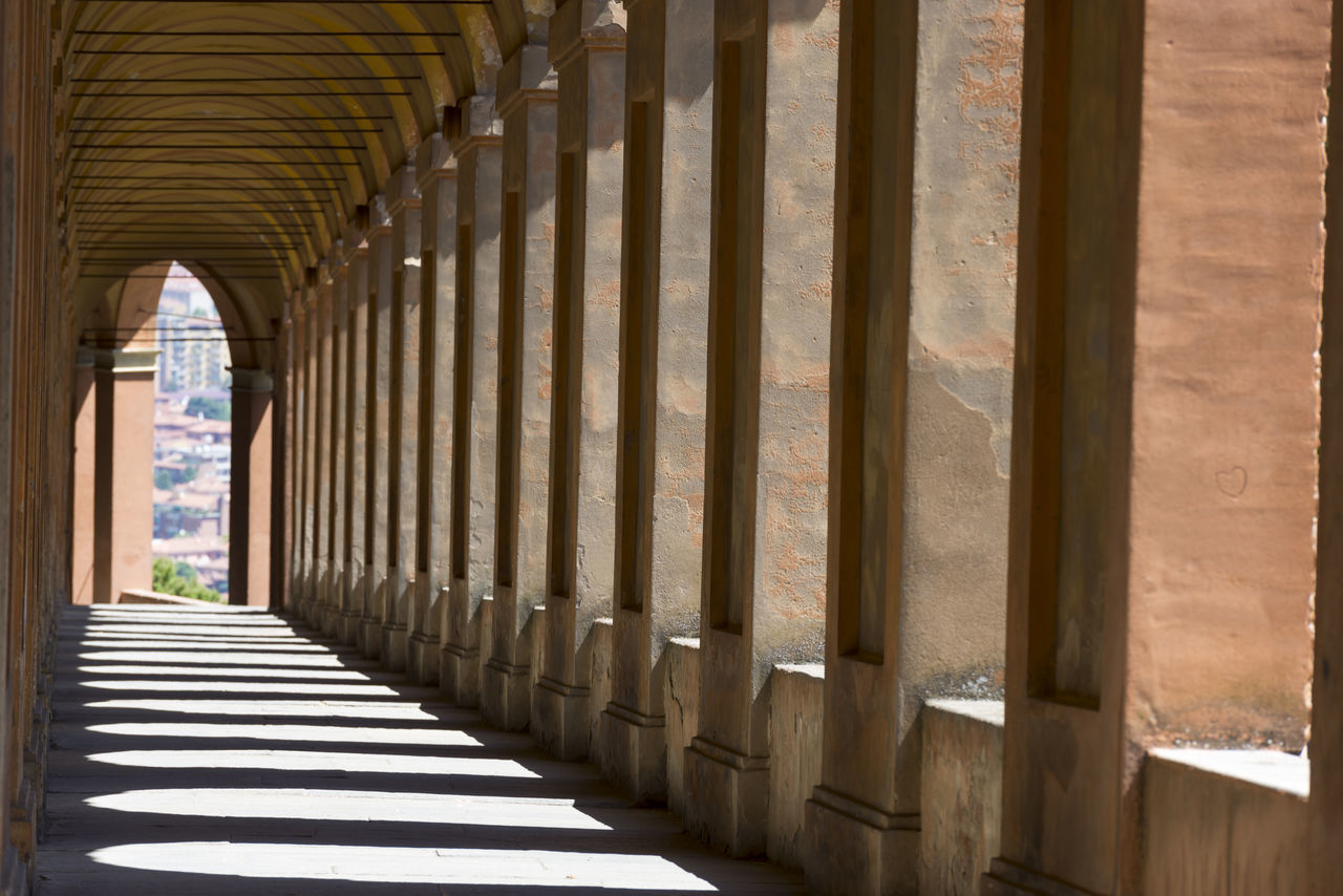 San Luca arcades in Bologna, Italy Ancient Arch Architectural Column Architectural Feature Architecture Built Structure Column Corridor Day Daydreaming Diminishing Perspective Famous Place Historic In A Row Landmark No People Repetition San Luca Shadow Sunny The Way Forward Travel Destinations Unesco Vanishing Point