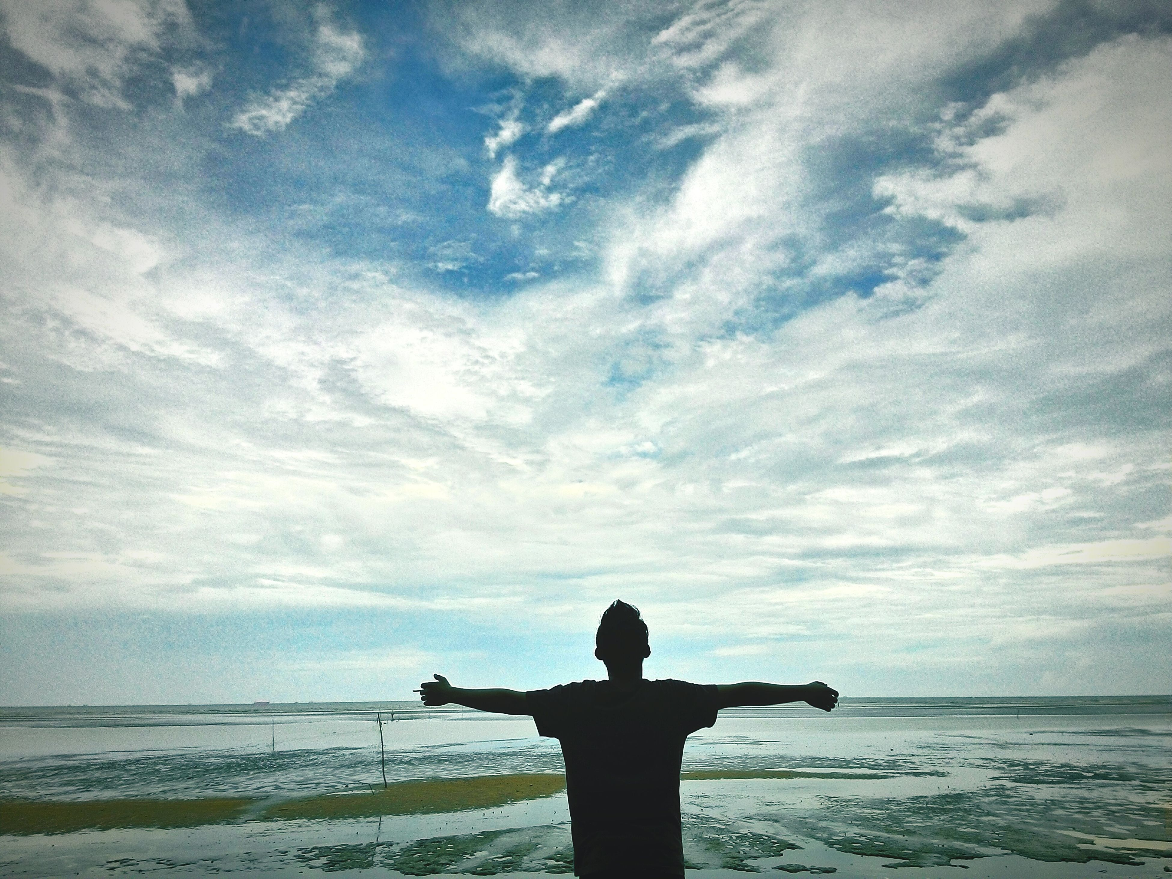 silhouette, sea, water, sky, standing, horizon over water, rear view, lifestyles, tranquility, leisure activity, tranquil scene, men, cloud - sky, scenics, beauty in nature, sunset, three quarter length, nature