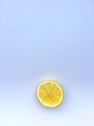 Lemon on white background Lemon Citrus Fruit Healthy Eating SLICE Fruit Food And Drink Freshness Copy Space Cross Section Studio Shot Vitamin C Halved No People Food Drink Refreshment Healthy Lifestyle Lime Indoors  White Background