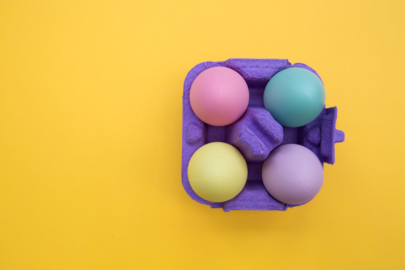 Easter eggs Bright Carton Colorful Colors Cute Easter Easter Eggs Overhead View Tray Yellow Yellow Background