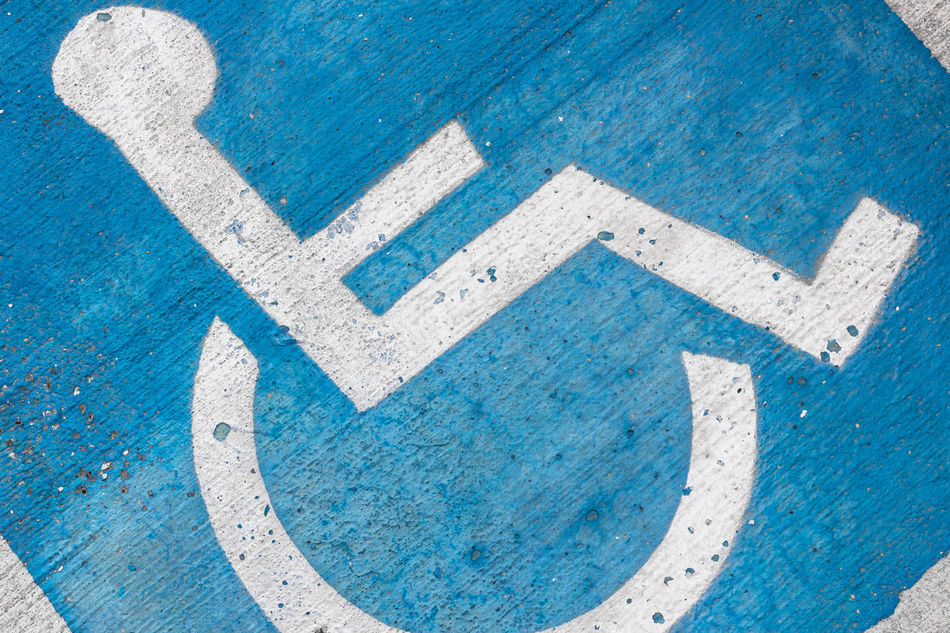 Disability symbol painted on the floor Access Asphalt Background Blue Care Disability  Disabled Handicap Handicapped Icon Invalid  Medical Paint Parking People Permit Reserved Road Sign Space Street Symbol Traffic Tranport Transportation