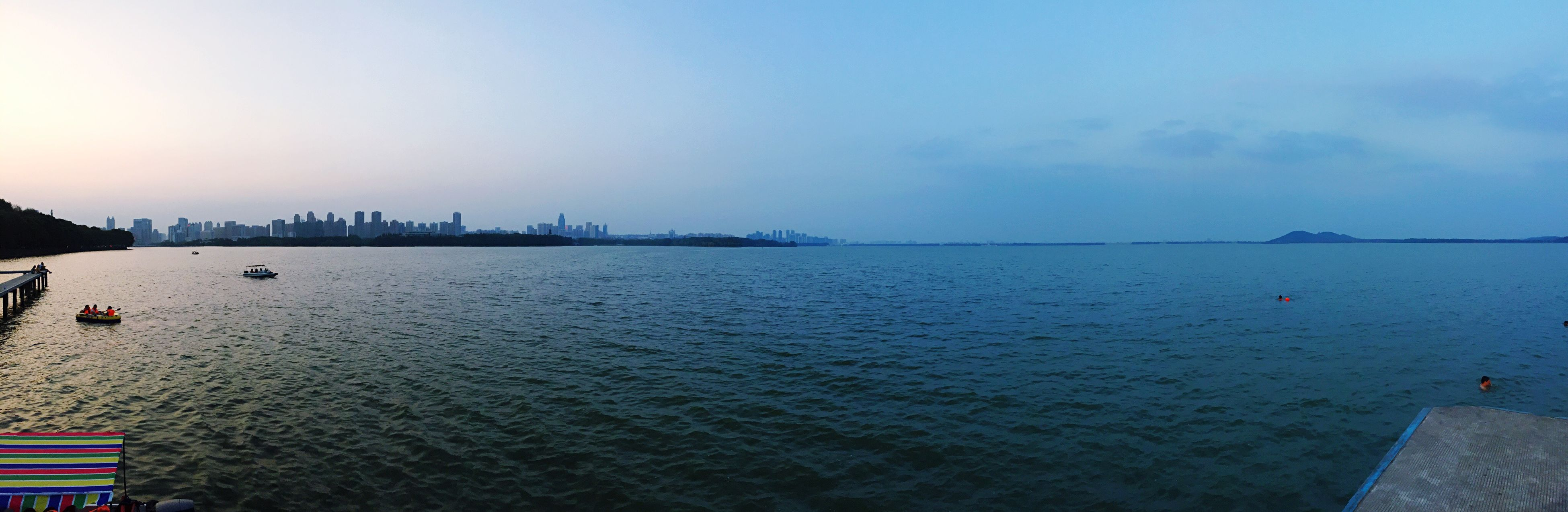water, sky, tranquil scene, tranquility, scenics, sea, city, calm, river, blue, day, waterfront, distant, nature, cloud, outdoors, ocean, beauty in nature, in front of, no people, harbor, urban skyline