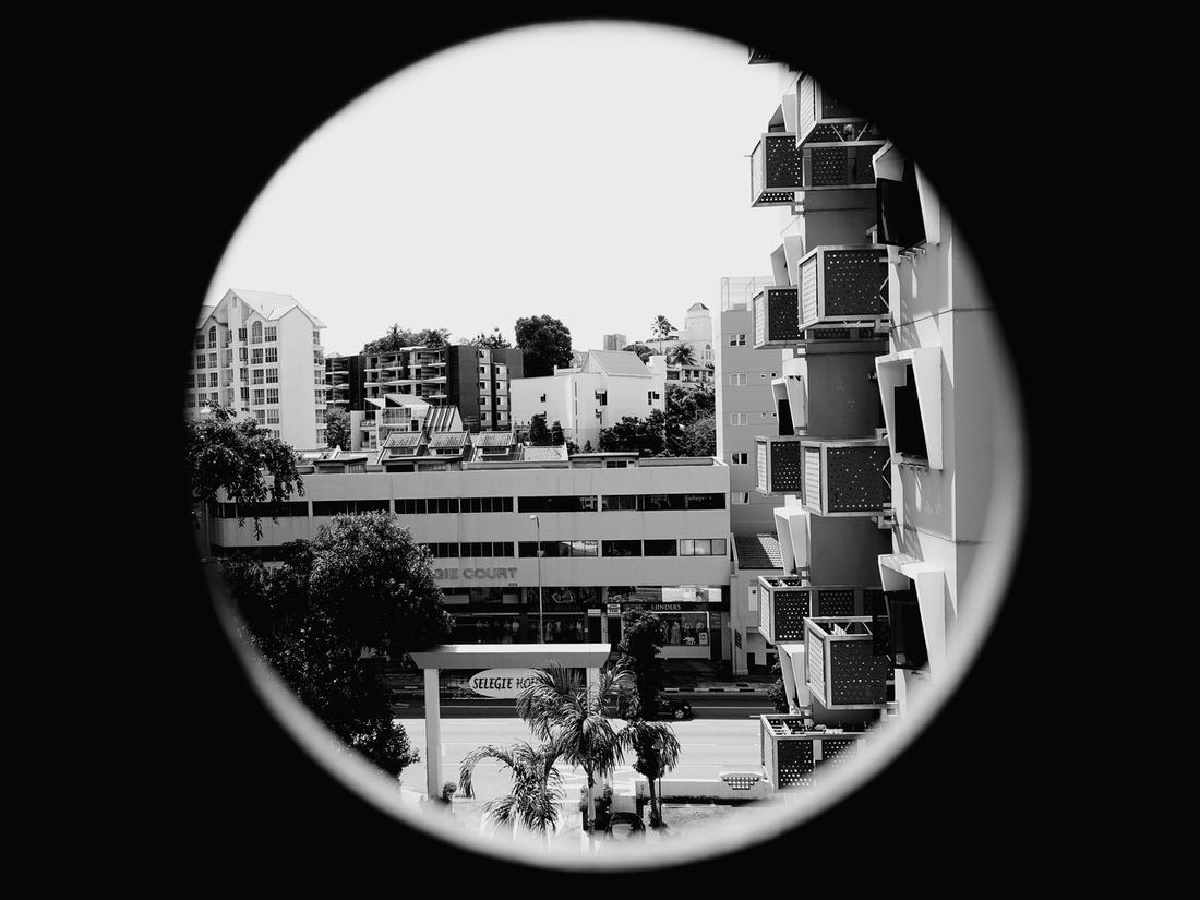 Peering out from Selegie House Circle Building Exterior No People Skyscraper Architecture City Cityscape Architecture The Week On EyeEm Urban Skyline Shadow Built Structure Singapore Black And White Friday