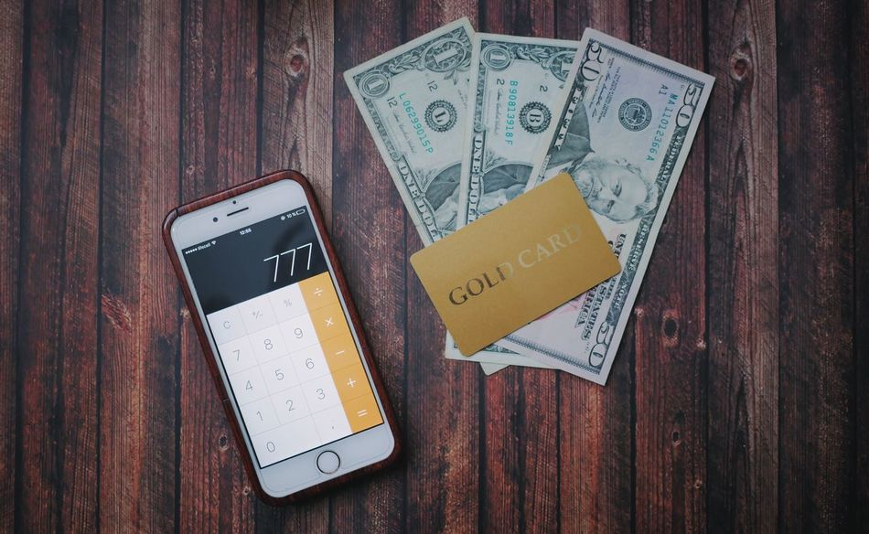 Portable Information Device Wireless Technology Smart Phone Mobile Phone Communication Indoors  Business Finance And Industry Wood - Material Technology No People Day Close-up Dollars Money Finance Financial District  Card Credit Card Gold Card Lucky