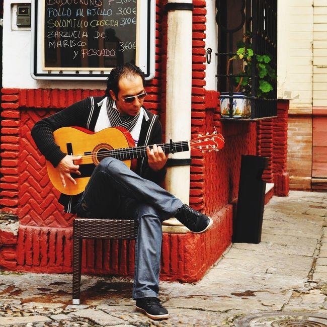Sevillano. Guitar Traveling SPAIN Urban