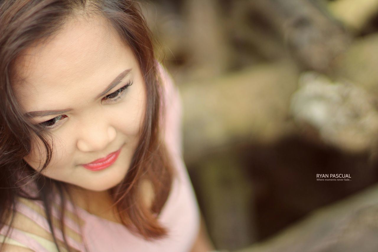 one person, real people, front view, communication, focus on foreground, headshot, close-up, day, young adult, childhood, outdoors, young women, people