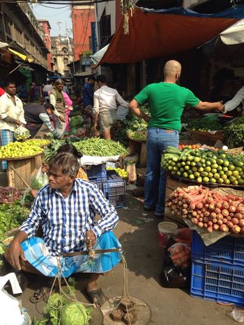 Early morning freshness in a otherwise chaotic vegetable market