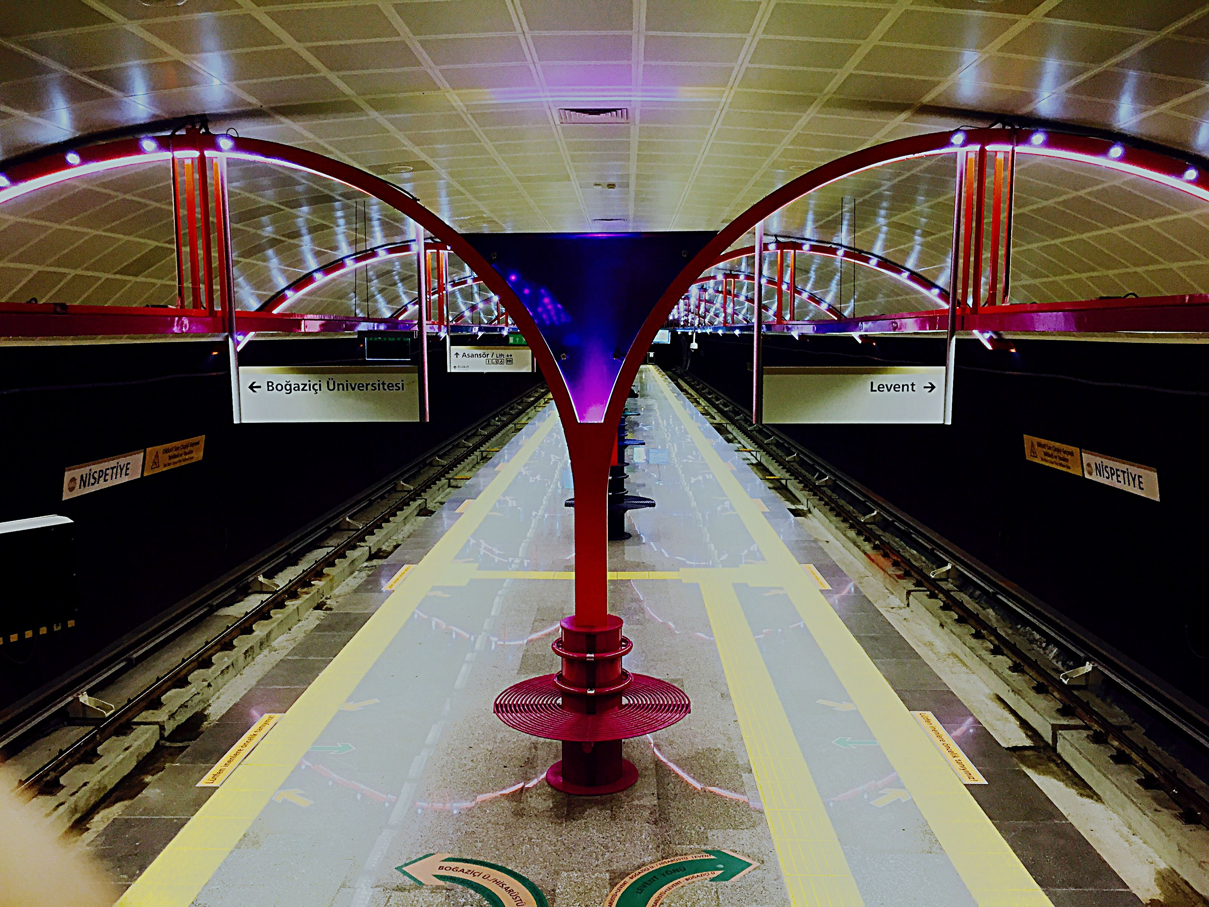 indoors, railroad station, transportation, illuminated, public transportation, rail transportation, railroad station platform, subway station, railroad track, architecture, travel, built structure, ceiling, train - vehicle, transportation building - type of building, subway, interior, incidental people, station, arch