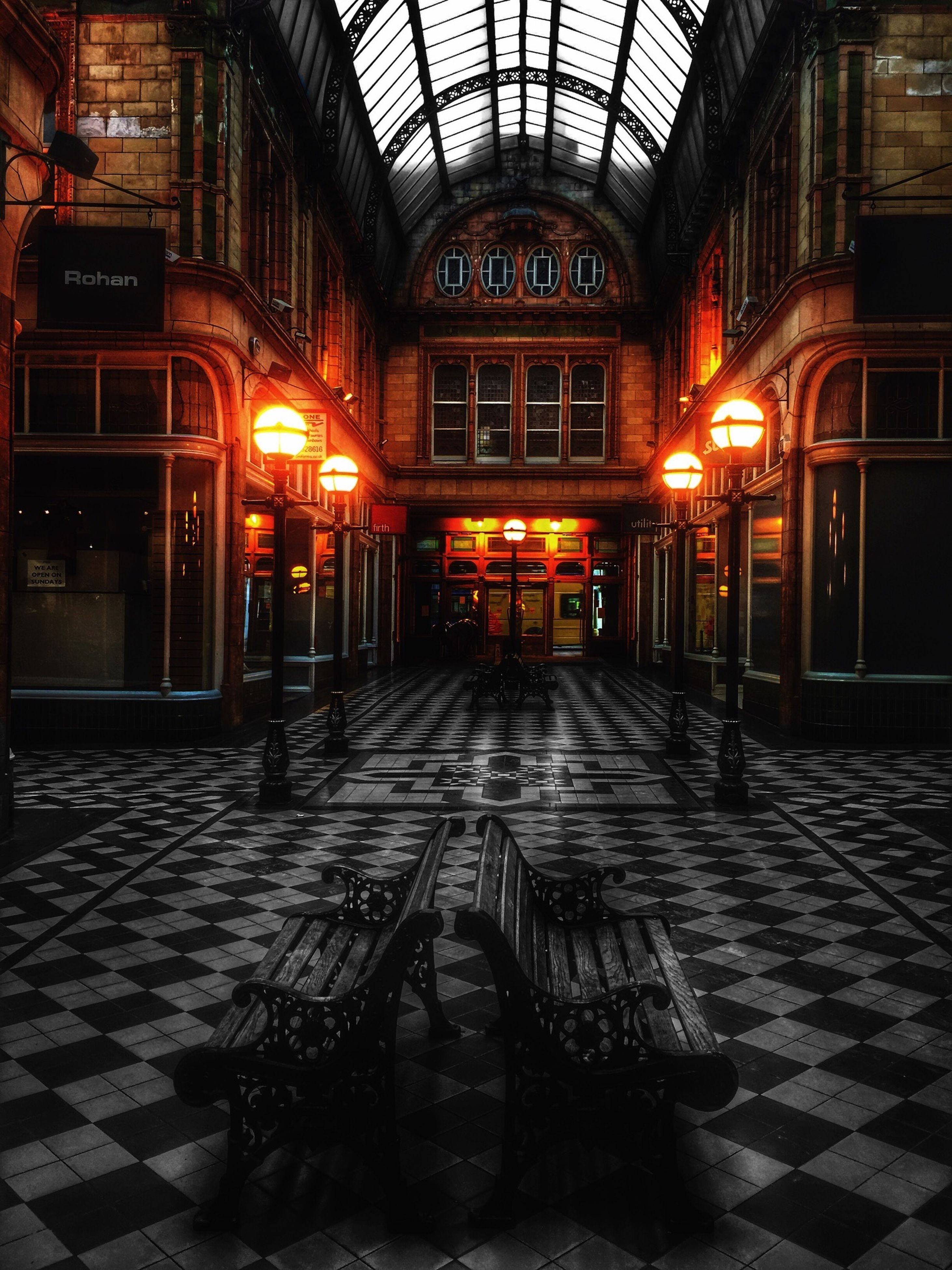 architecture, built structure, illuminated, building exterior, empty, night, the way forward, cobblestone, absence, building, indoors, lighting equipment, no people, arch, door, flooring, diminishing perspective, city, walkway, window
