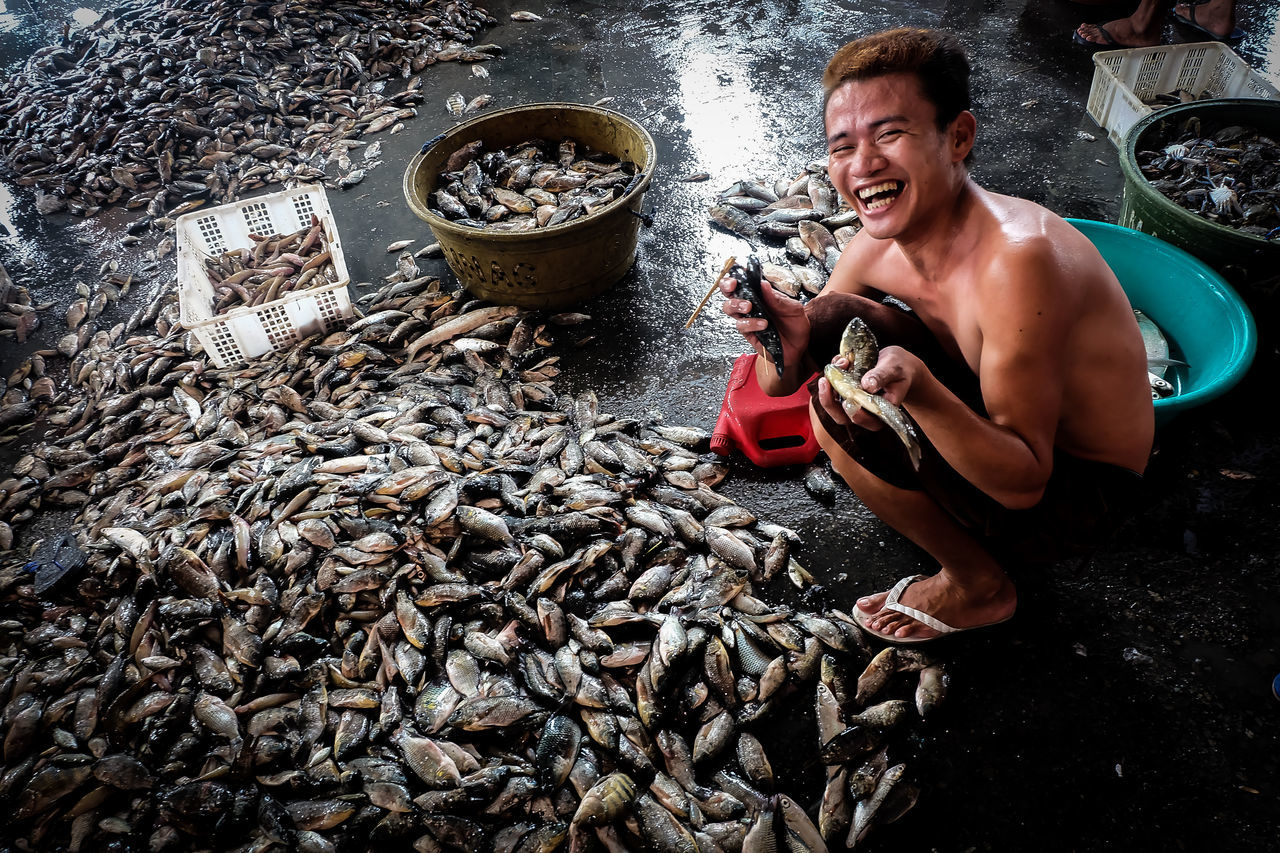 Fish Markets Cheerful Fish Port Happiness Lifestyles Market Stall People Real People Smiling Trader