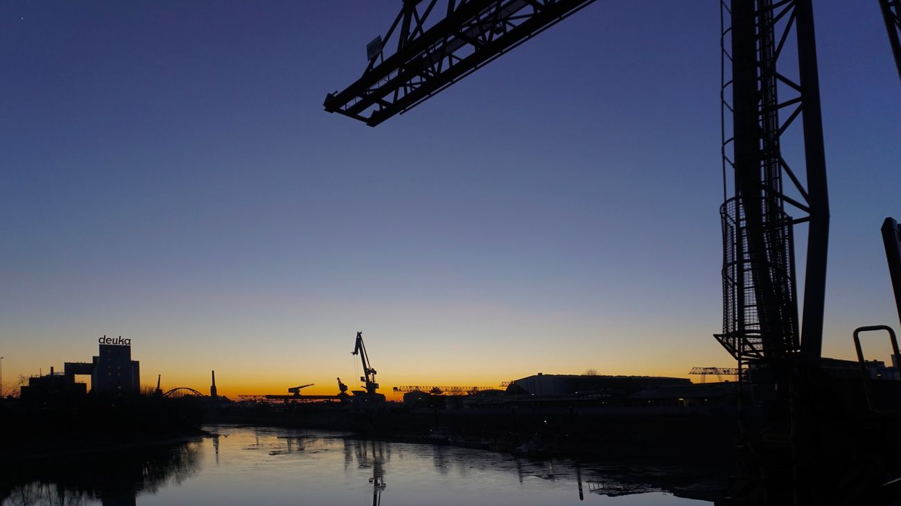 At the waterfront No. 7/9. Water Built Structure Sky Waterfront Clear Sky No People Architecture Outdoors Low Angle View Building Exterior Nature River Silhouette City Sunset Beauty In Nature Day ❤️ Düsseldorf Water Reflections Harbour Crane Brigde Construction Transportation
