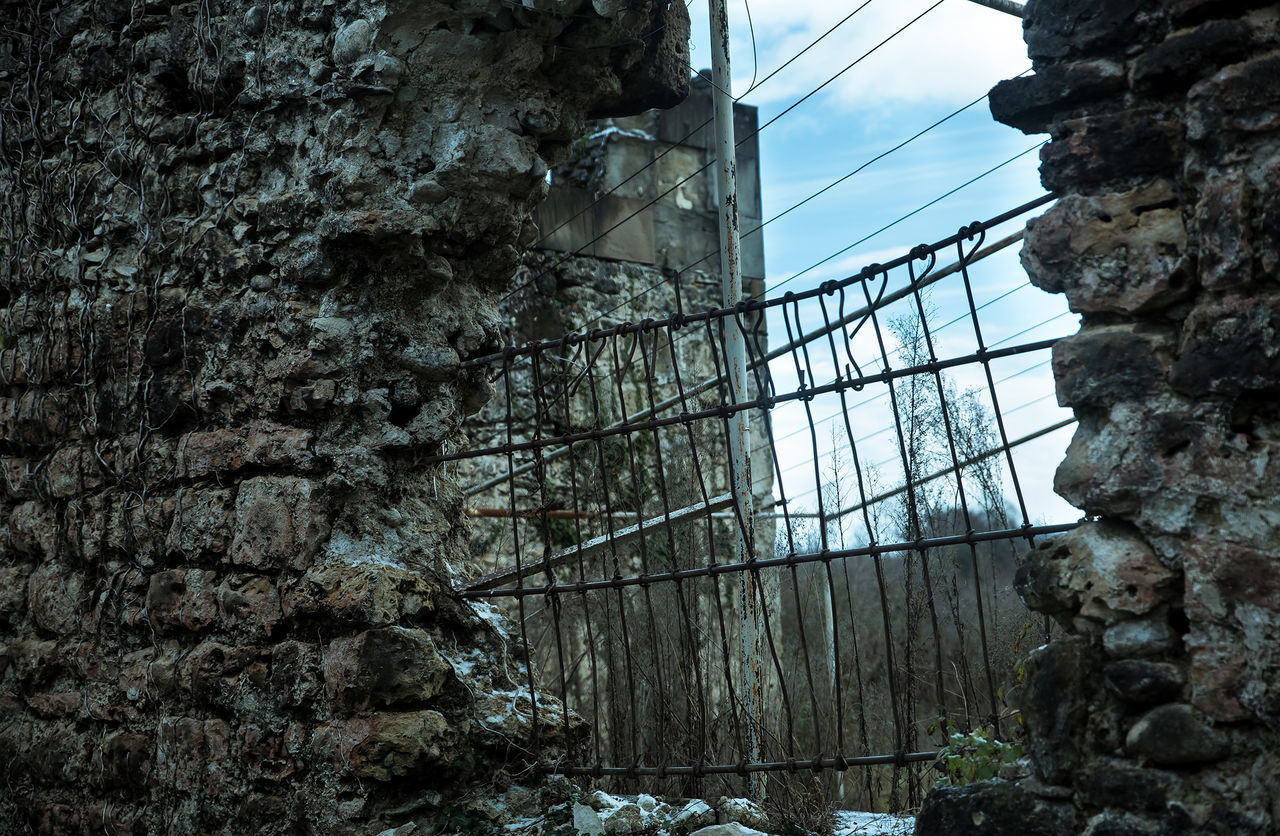 Low Angle View Of Damaged Wall