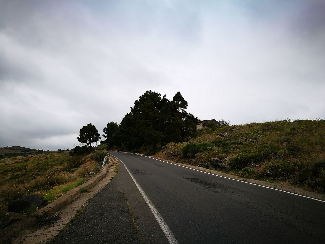 road, the way forward, sky, transportation, tree, day, no people, outdoors, tranquility, nature, landscape