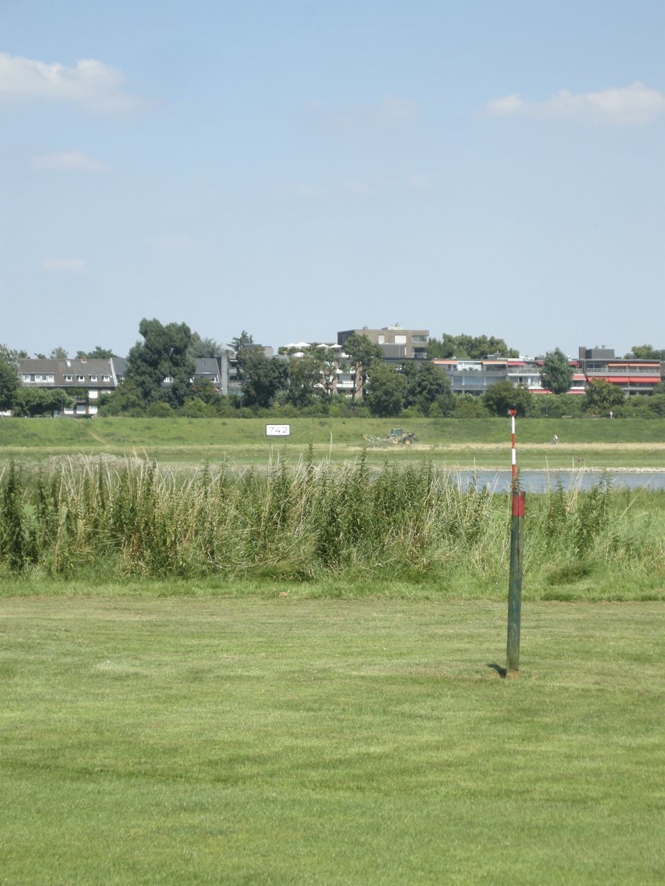 grass, sky, field, day, no people, tranquility, outdoors, playing field, sport, tree, goal post, scenics, cloud - sky, nature, landscape, beauty in nature, soccer field, golf, green - golf course, golf course