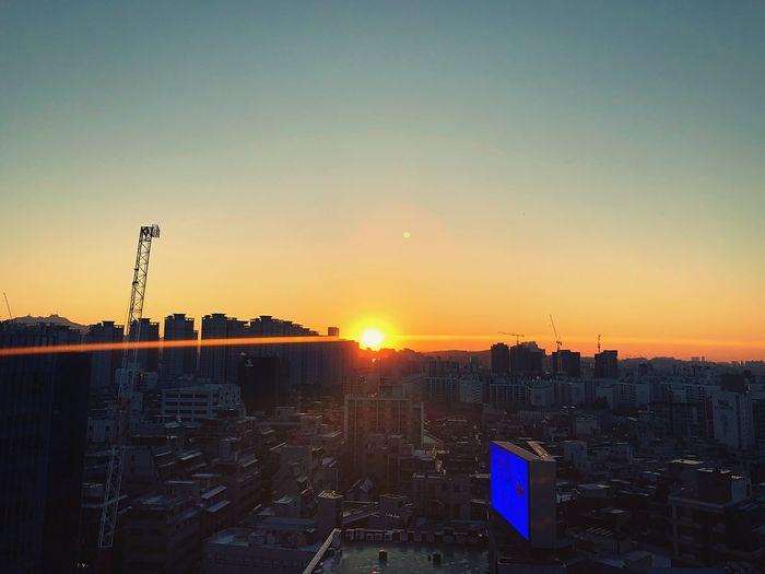 파워퇴근 IPhone IPhoneography Sunset Architecture Building Exterior Built Structure City Cityscape Clear Sky No People Sun Sky Skyscraper Outdoors Day