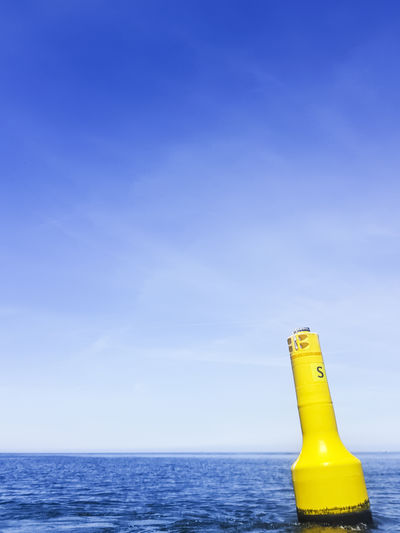 Copy Space EyeEm Nature Lover EyeEm Gallery On The Water Tranquility Beach Blue Blue Sky Buoy Eye4photography  Horizon Over Water Minimal Minimalism Minimalobsession Nature No People Ocean Scenics Sea Water Yellow Paint The Town Yellow