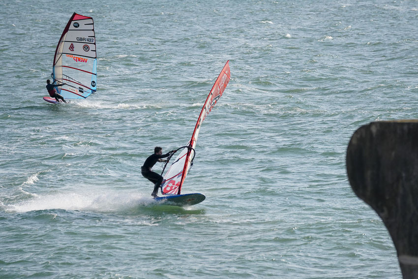 Windsurfers racing off Hayling Island sea front in Hampshire, UK. England Europe Fast GYBE Gybing Hampshire  Hants Hayling Island  Jibe Racing Sail Sailboard Sailboarding Sailing Slalom Slalomboard Slalomtraining Speed Uk Windsurf Windsurf Life Windsurfer Windsurfers Windsurfing Windy