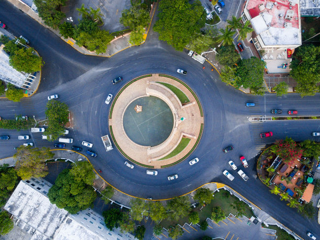Vertical shot above Merida, Mexico Aerial Shot Dramatic Sky Drone  Mérida Mérida Yucatán Paseo De Montejo Aerial Aerial Photography Aerial View Architecture Building Exterior Built Structure Circle City Day Drone Photography High Angle View Modern Montejo No People Outdoors Road Roundabout Tree Water