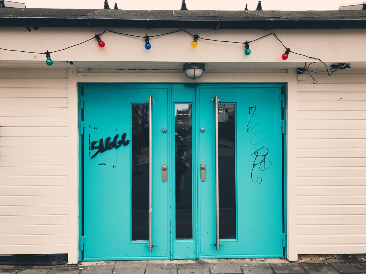 Door Building Exterior Built Structure Closed Blue Architecture Entrance Front Door Outdoors Day No People Entry Colorful Turquoise Closed Door Doors Background Colored Lights Entrance Wall - Building Feature Spray Paint Lights Electric Light Hanging