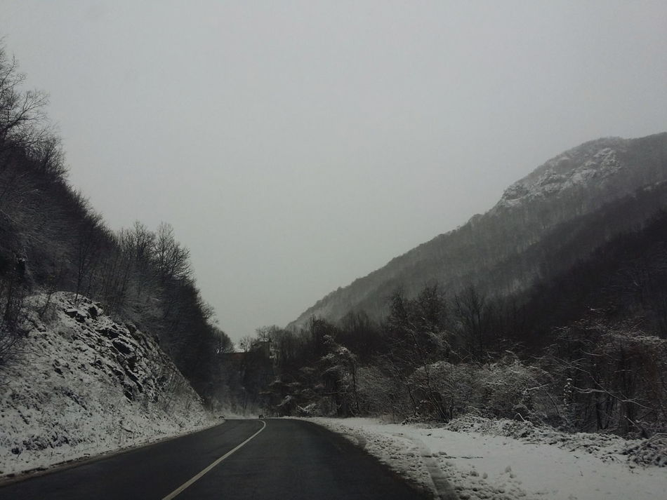 Cold Cold Temperature Composition Copy Space Fog From My Point Of View Landscape Mountain Mountain Range Nature Non-urban Scene Perspective Physical Geography Remote Road Roadtrip Scenics Snow Tranquil Scene Tranquility Weather Winter Landscapes With WhiteWall