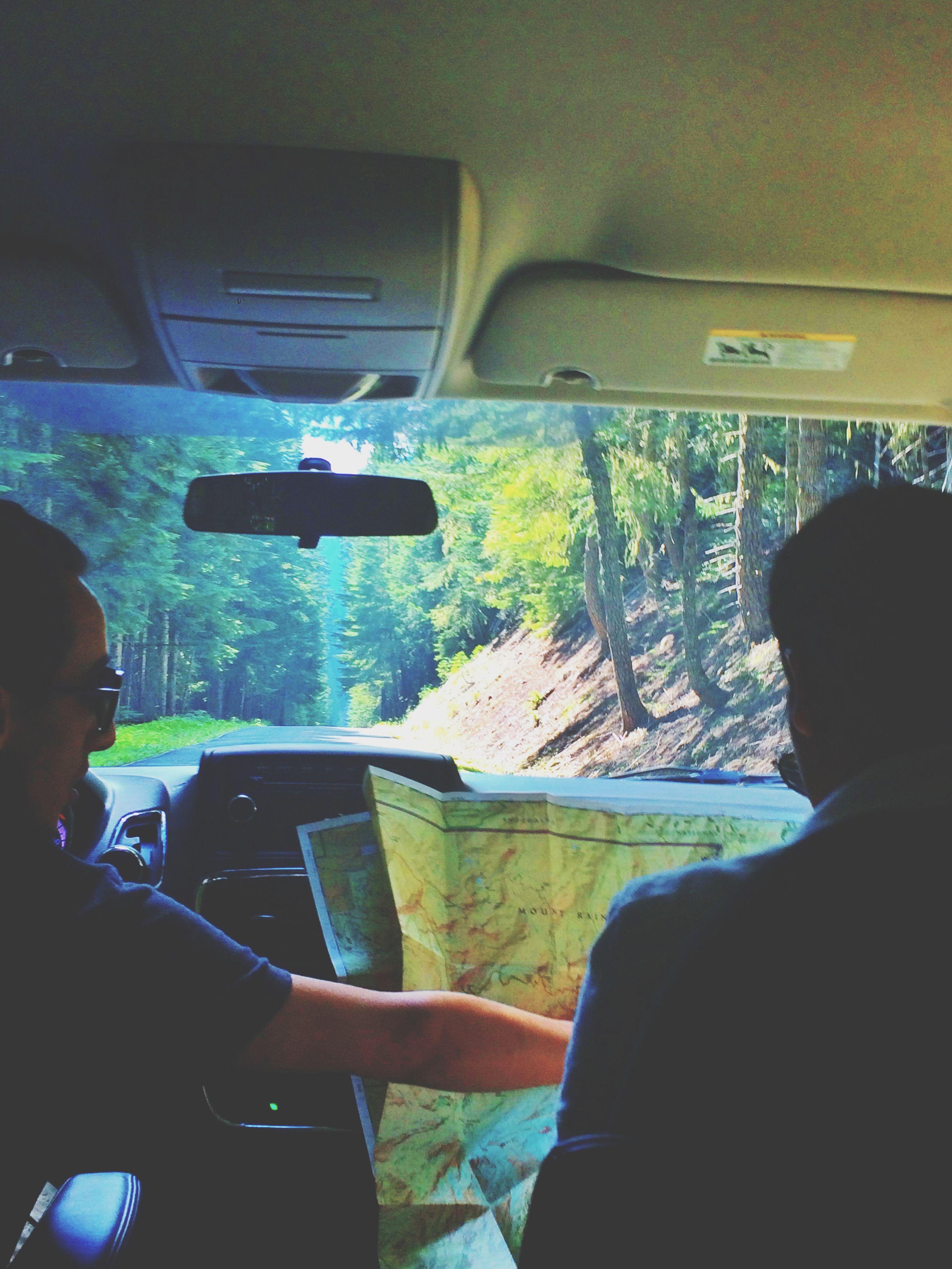 transportation, vehicle interior, lifestyles, mode of transport, land vehicle, car, men, leisure activity, window, travel, indoors, sitting, car interior, vehicle seat, headshot, journey, technology, rear view