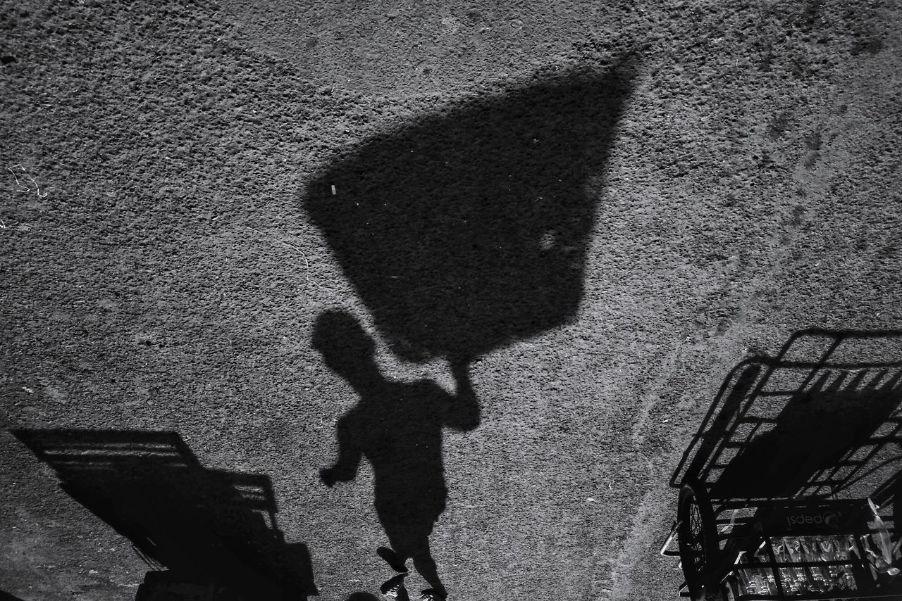 Shadow Focus On Shadow High Angle View Sunlight Day Outdoors Textured  Real People One Person Break The Mold Vendor Market Labor Day Working People Eyeem Philippines EyeEmPHLaborDay2017 Street Streetphotography Streetphoto_bw The Week On EyeEm The Street Photographer - 2017 EyeEm Awards The Photojournalist - 2017 EyeEm Awards