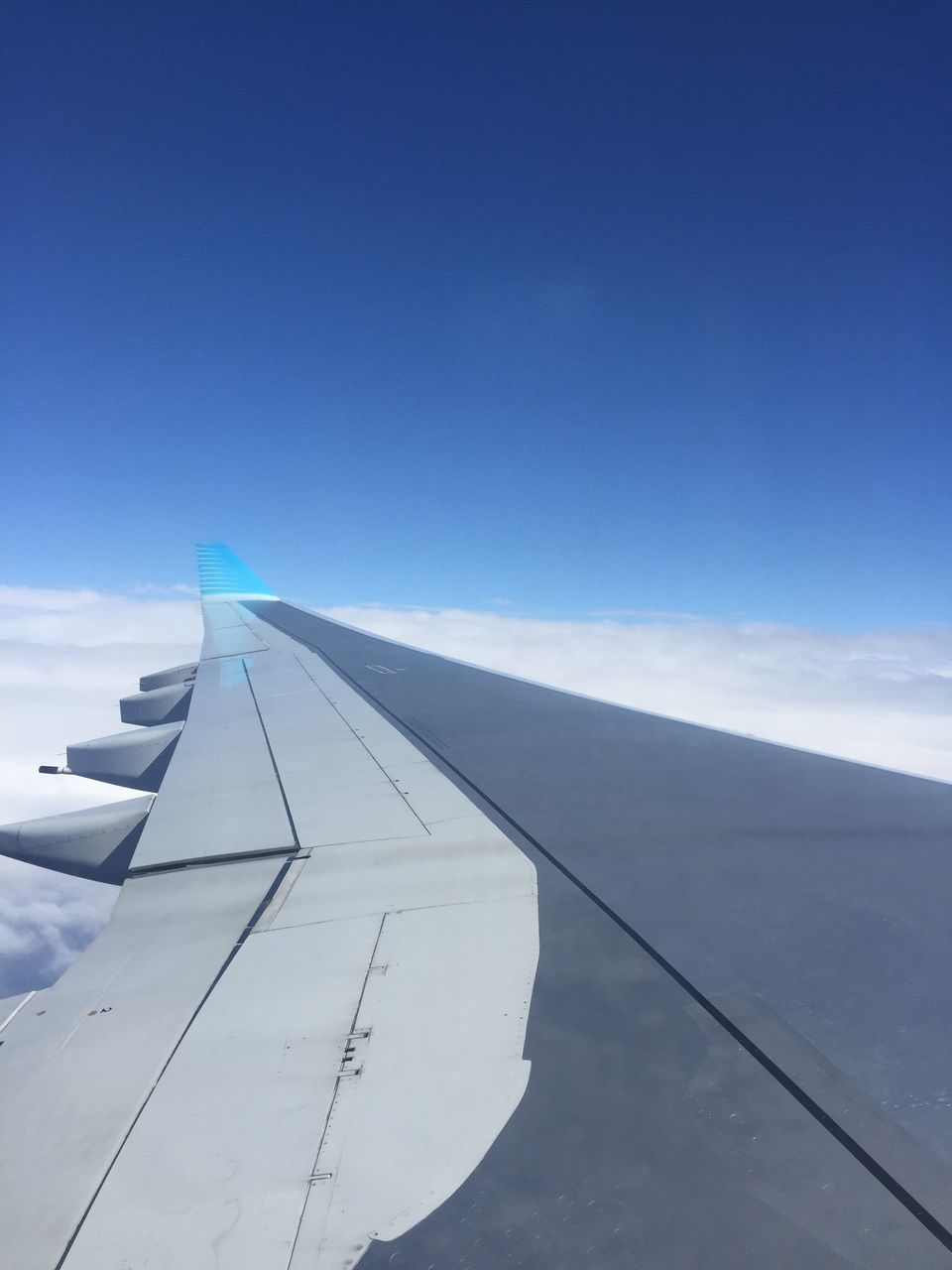 airplane, transportation, travel, blue, air vehicle, sky, mode of transport, journey, flying, no people, day, airplane wing, aircraft wing, outdoors, cloud - sky, nature, commercial airplane, close-up