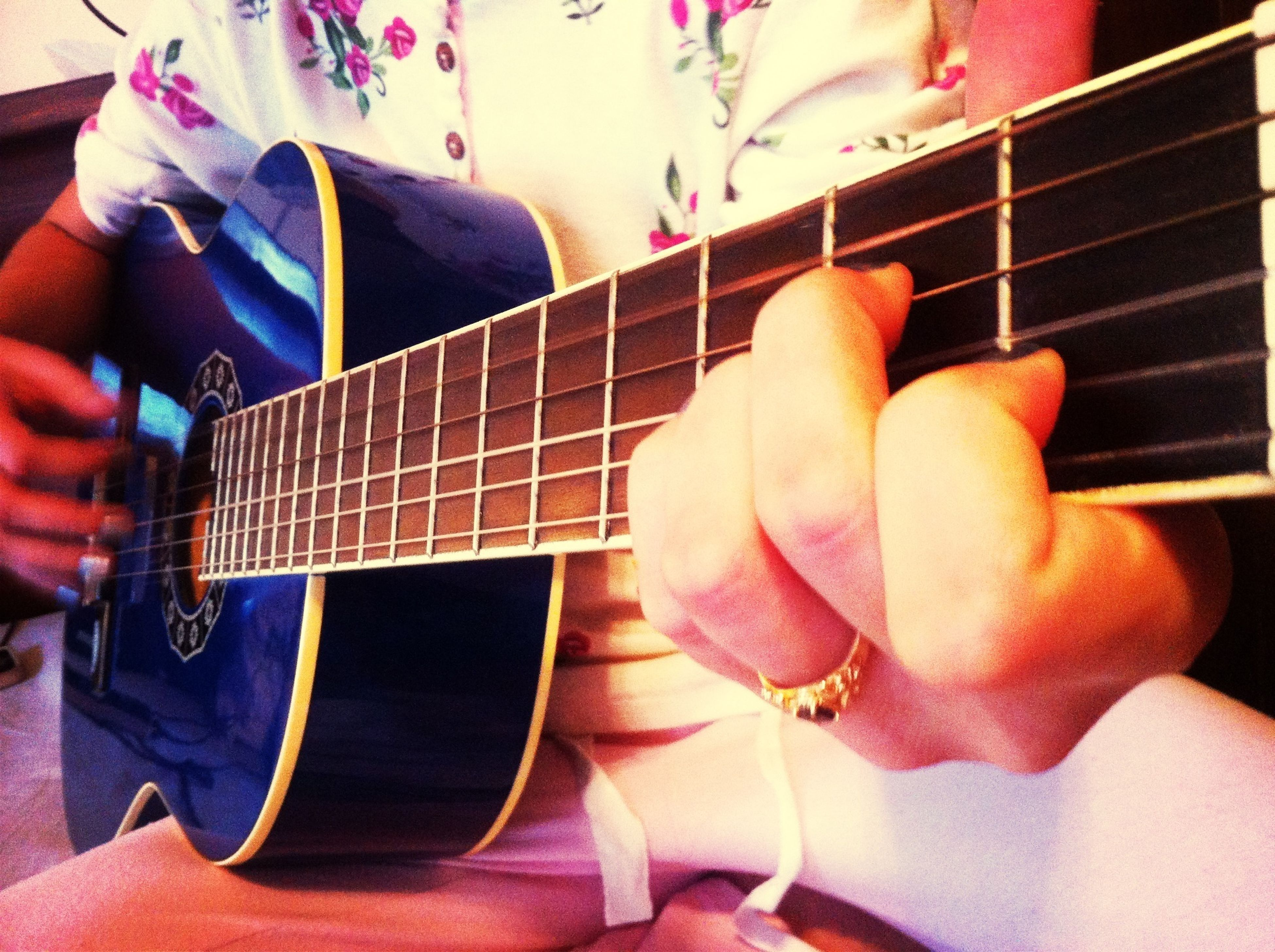 indoors, person, lifestyles, part of, music, musical instrument, holding, leisure activity, men, arts culture and entertainment, guitar, high angle view, sitting, technology, close-up, hobbies