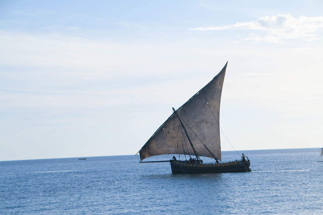 Traditional Sail Fishing Boat in Zanzibar Cloud - Sky Day Dhow Boat Fisherman Fishing Fishing Sail Boat Horizon Over Water Indian Ocean Journey Nature Nautical Vessel No People Outdoors Sailboat Sailing Sailing Ship Sea Sky Traditional Sailboat Transportation Travel Water