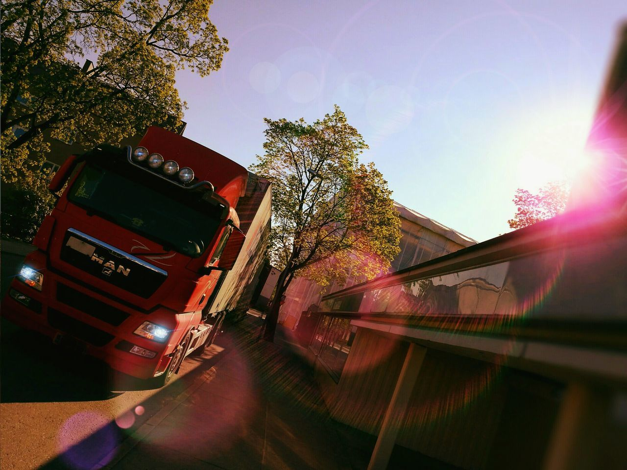 WorkingTruck Long VehicleUnloading Small Street Sunshine Lensflare Morning Sun Morning