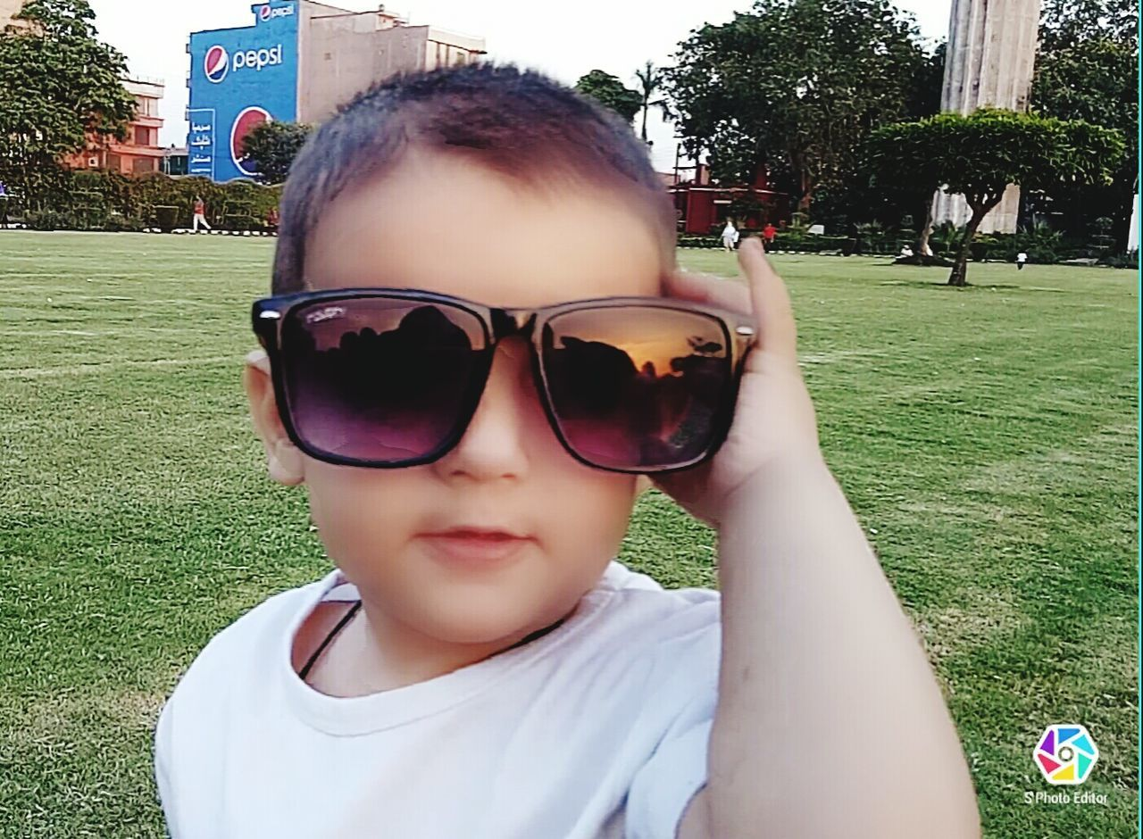 Don Child Childhood Children Only One Person Sunglasses People Grass Portrait Protruding One Girl Only Happiness Day Headshot Real People Smiling Leisure Activity Outdoors Sticking Out Tongue Boys Human Body Part Hanging Out Check This Out Close-up Uniqe Uff