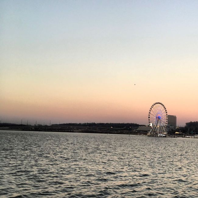 Ferris Wheel Waterfront Outdoors Travel Destinations Ferris Wheel Clear Sky City Water Building Exterior Sunset Sea No People Architecture Day Nature Sky Washington, D. C. Arts Culture And Entertainment Boating Boatlife Potomac River Sunset