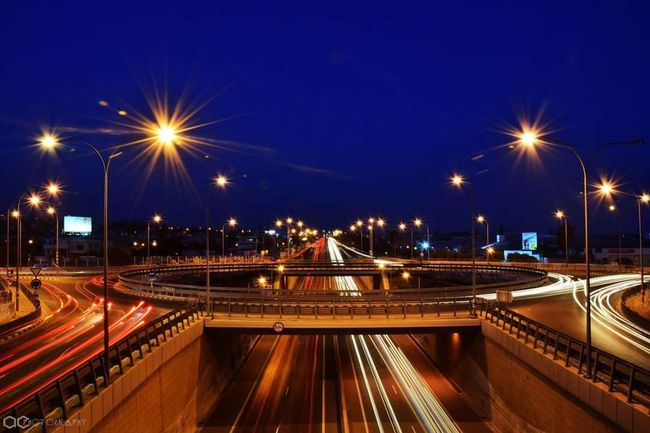 capturing motion Night City Architecture Illuminated Built Structure City Life Bridge - Man Made Structure Transportation Street Light Motion Traffic Travel Destinations Building Exterior Cityscape Highway Light Trail No People Outdoors Long Exposure Urban Skyline