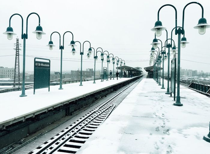 Snow and subway Transportation Rail Transportation Railroad Track Railroad Station Woodside New York Woodside Sky The Way Forward Railroad Station Platform Built Structure Winter Architecture Day Cold Temperature Nature