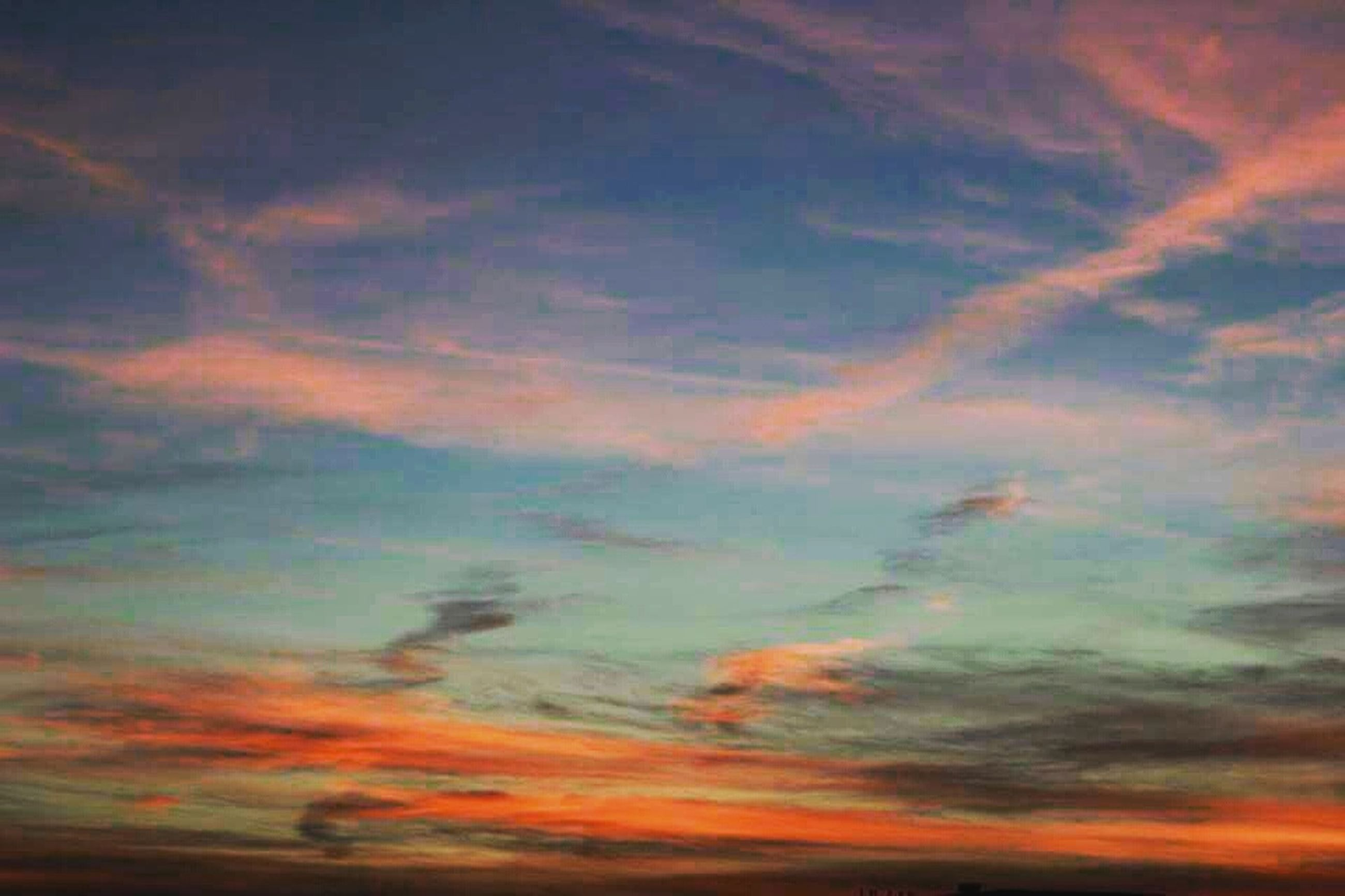 sunset, sky, cloud - sky, orange color, beauty in nature, scenics, tranquility, low angle view, tranquil scene, cloudy, dramatic sky, nature, sky only, idyllic, cloudscape, backgrounds, cloud, majestic, weather, full frame