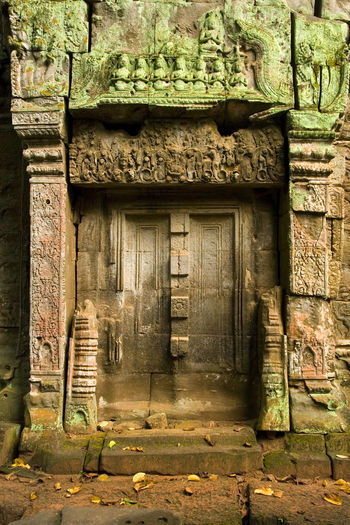 Ta Prohm temple ancient blind doors with carvings at Angkor, Siem Reap Province, Cambodia, Southeast Asia Adventure Ancient Ancient Civilization Angkor Architecture Architecture_collection Architecturelovers Architecturephotography ASIA Blind Door Building Cambodia Carving Closed Door Door Doors Gate Historic Historical Building Mysterious Mystery Passage Portal Relief Siem Reap