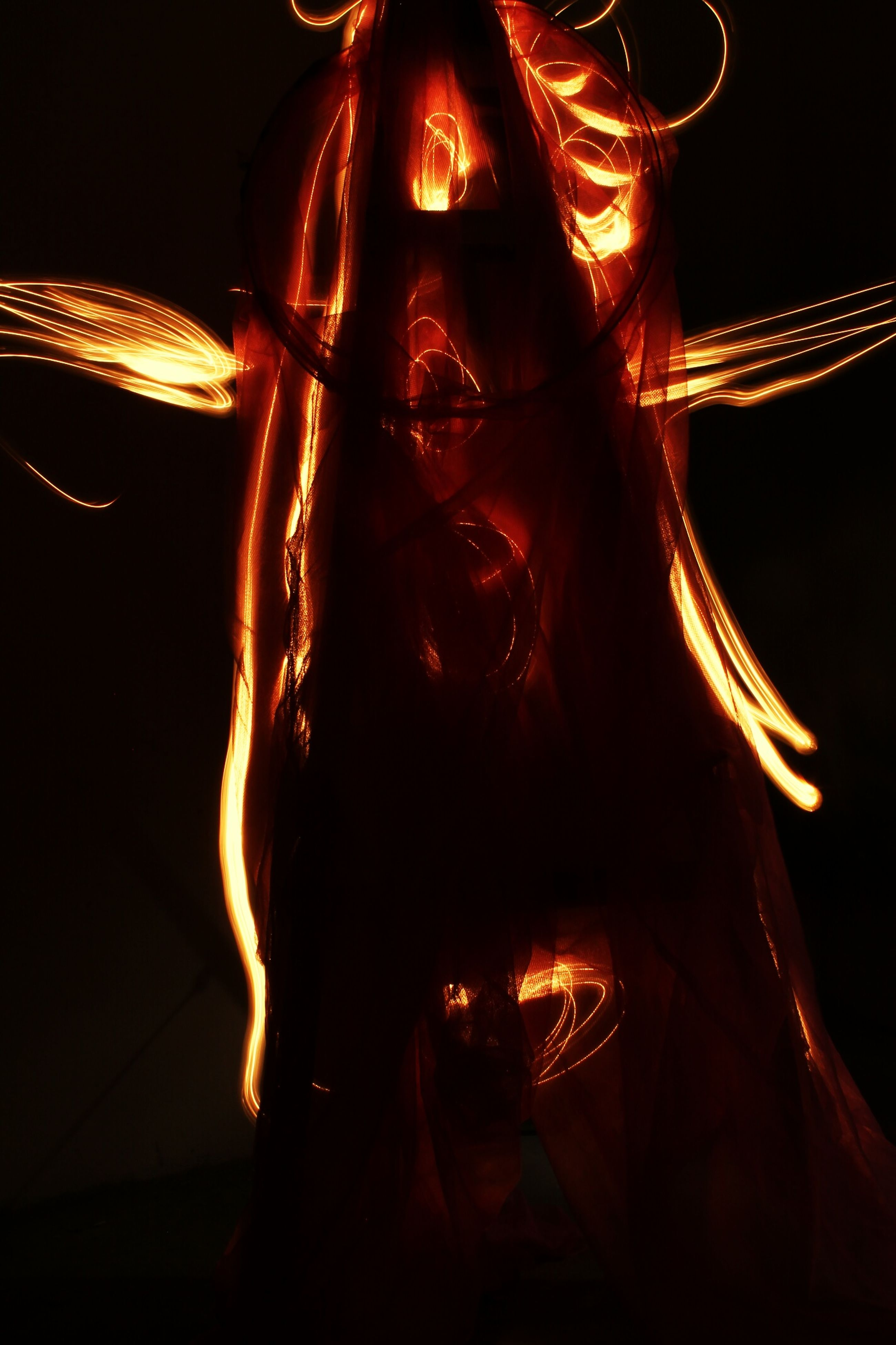 night, illuminated, dark, glowing, fire - natural phenomenon, low angle view, light - natural phenomenon, burning, arts culture and entertainment, lighting equipment, close-up, flame, indoors, no people, long exposure, tradition, lit, celebration, black background