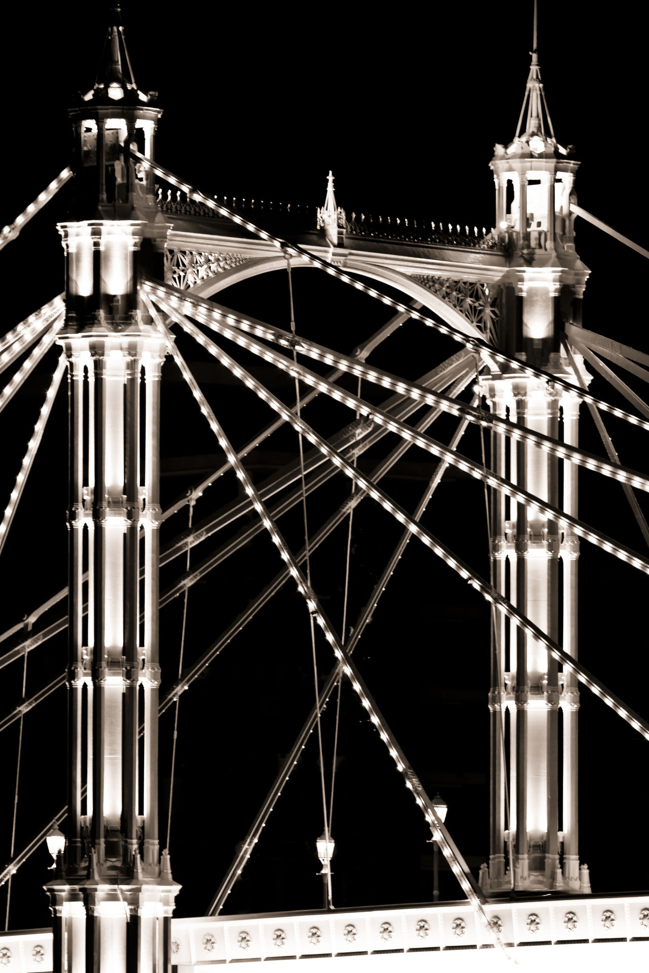 Albert Bridge, Chelsea, London Albert Bridge Architecture Bridge Built Structure Chelsea Detail Famous Place Illuminated International Landmark Light London Majestic Night Nightphotography No People Outdoors Tourism Tower Travel Destinations Vacations