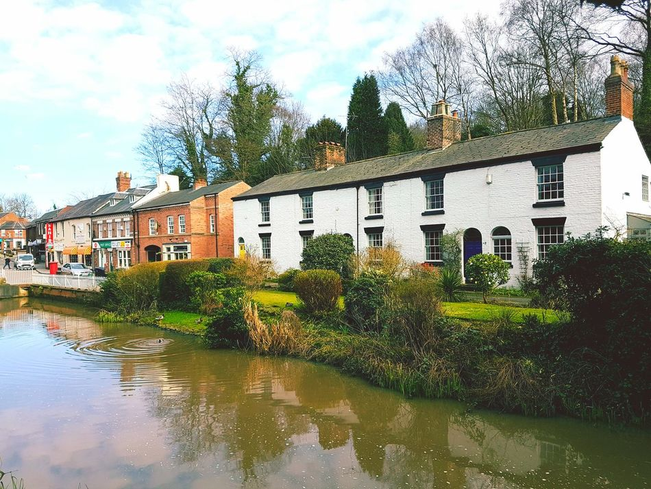 Reflection Water Tree Building Exterior White Cottage Built Structure Architecture Outdoors No People Nature English Village Quaint Village Beauty Around Us