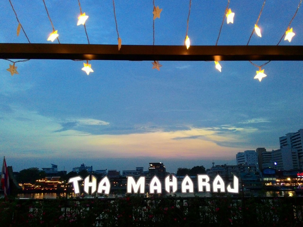 Communication Sky City Night Star The MaharajaPalace Text Architecture Illuminated Outdoors Building Exterior Built Structure No People Low Angle View Cityscape Blue Sky