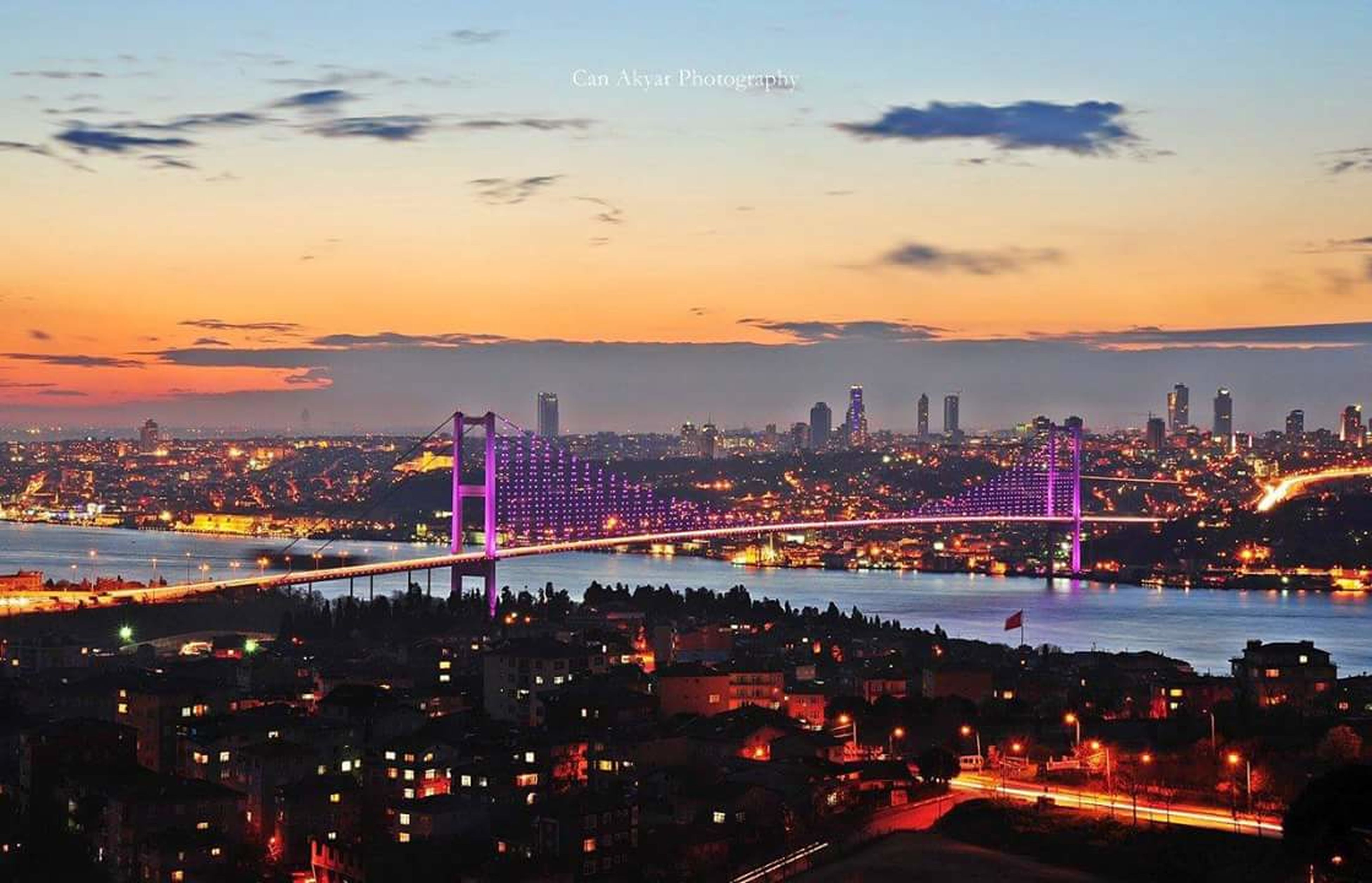 architecture, city, built structure, cityscape, illuminated, building exterior, bridge - man made structure, connection, sky, capital cities, river, high angle view, travel destinations, night, crowded, city life, skyscraper, sunset, famous place, tower