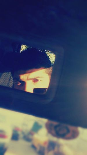 Eyes in Mirror with Sunshining Sun