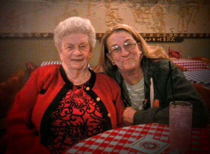 Two People Togetherness Senior Adult Senior Women Adult Women Indoors  Portrait Lifestyles Love Adults Only People Eyeglasses  Females Bonding Real People Looking At Camera Smiling Sitting Friendship Connected By Travel