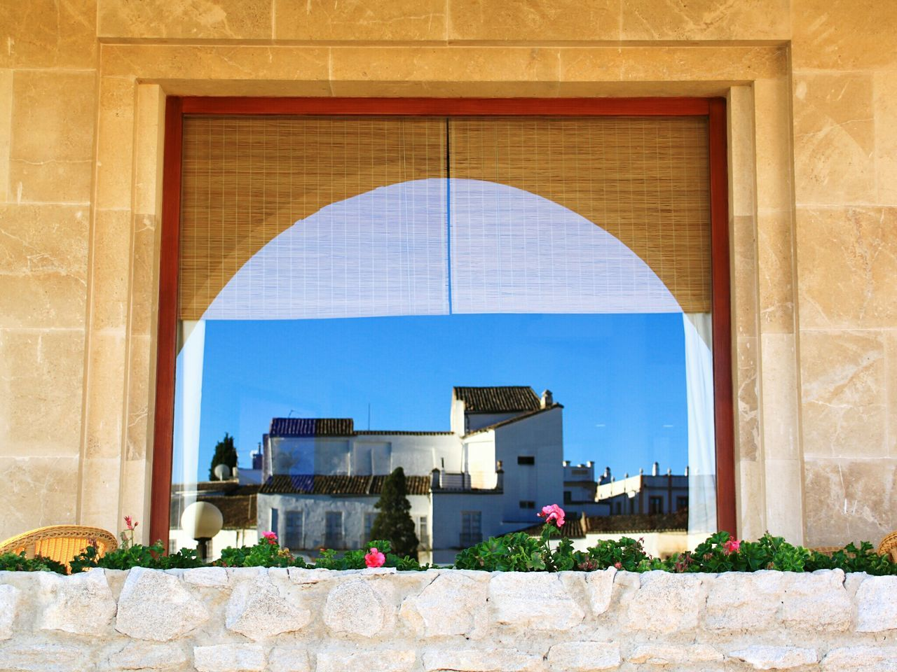 Architecture No People Travel Destinations Building Exterior Outdoors Day Blue Clear Sky Travel Sky Cityscapes Check This Out EyeEm Gallery White Houses Ronda, Malaga Ronda Spain Ronda Window Reflection Reflection_collection Reflection In The Window Reflections In The Glass Windows Framed Frame It! Arch