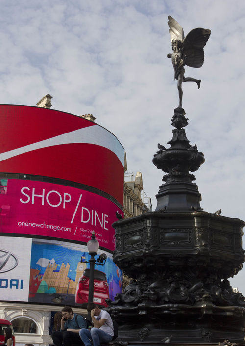 Architectural close up of the Shaftesbury Memorial Fountain in Piccadilly Circus in London, with famous led signs in the background Capital City Fountain London Monument Neon Sign No People Piccadilly Circus Shaftesbury Memorial Fountain
