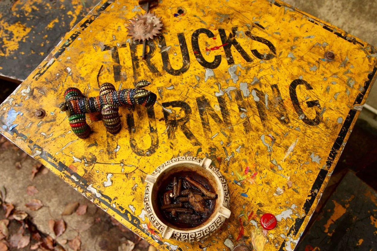 Animal Themes No People One Animal Close-up Day Outdoors Sign Vintage Dirty Cigarette  Looking Down Yellow Trucks Australia Nimbin Hippie Colour EyeEm Best Shots Canon Art Is Everywhere Bottle Cap Bottle Cap Art
